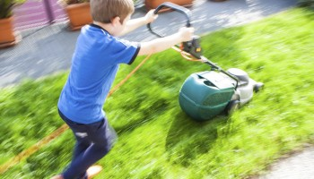 Child and lawnmower