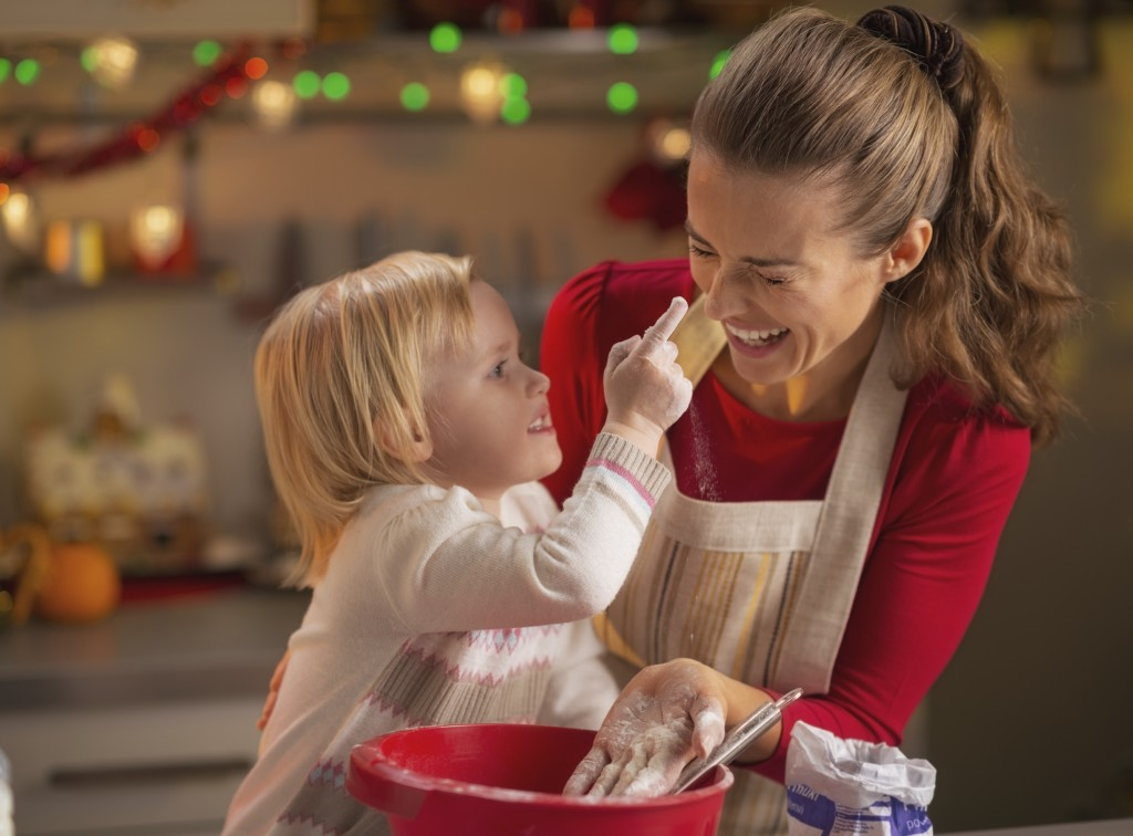 child-smear-moms-nose-with-flour_istock_000030527776_large