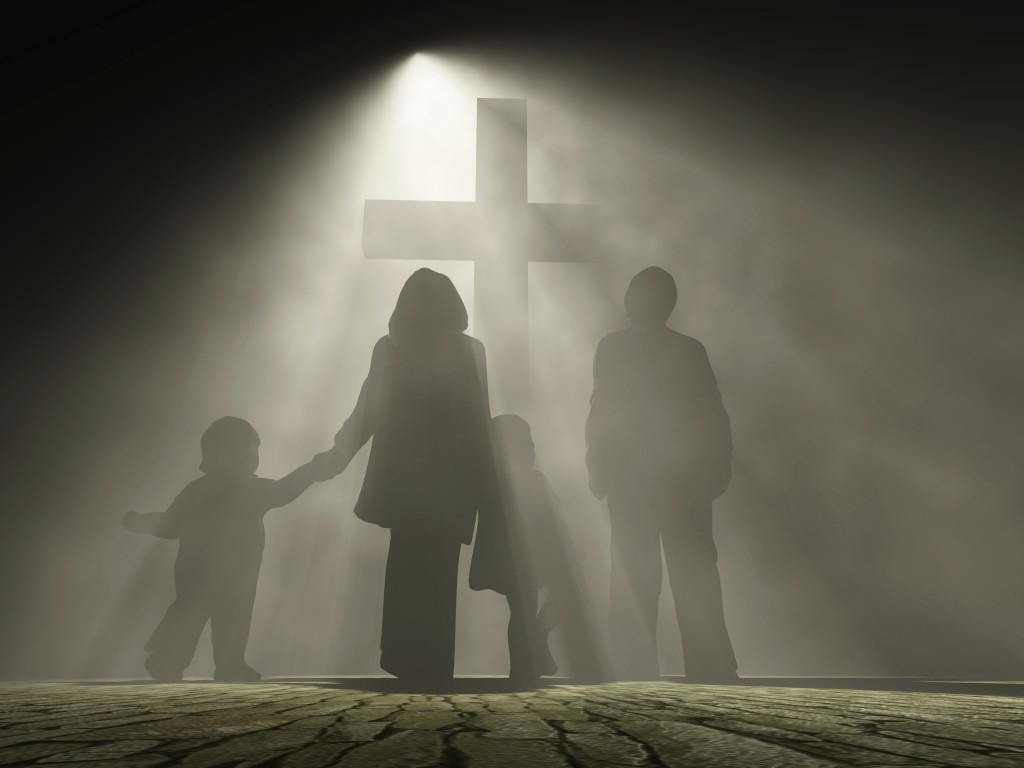Family in front of cross