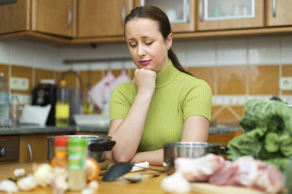 Tired woman at kitchen