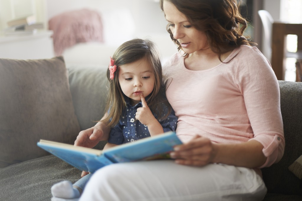 mom & daughter reading a book