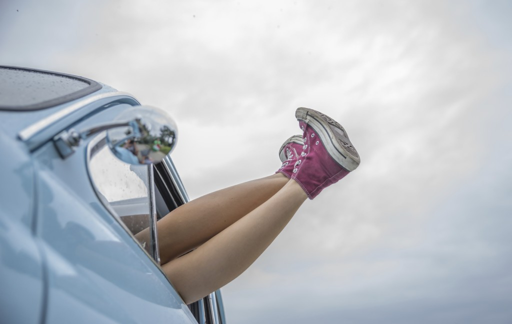 feet hanging out of a car