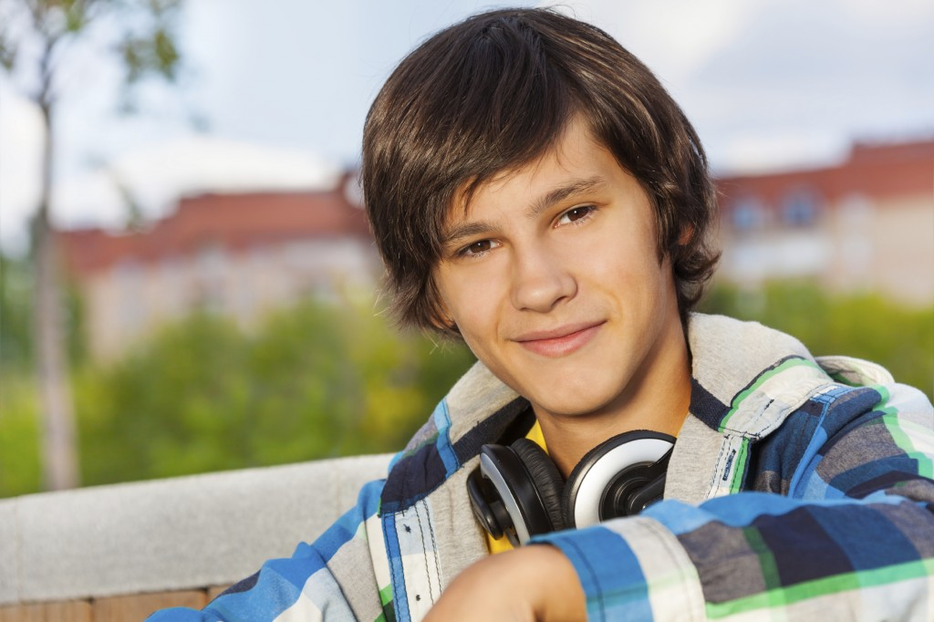 Close up view of boy wearing headphones