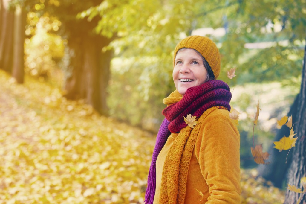 woman enjoying the fall colors