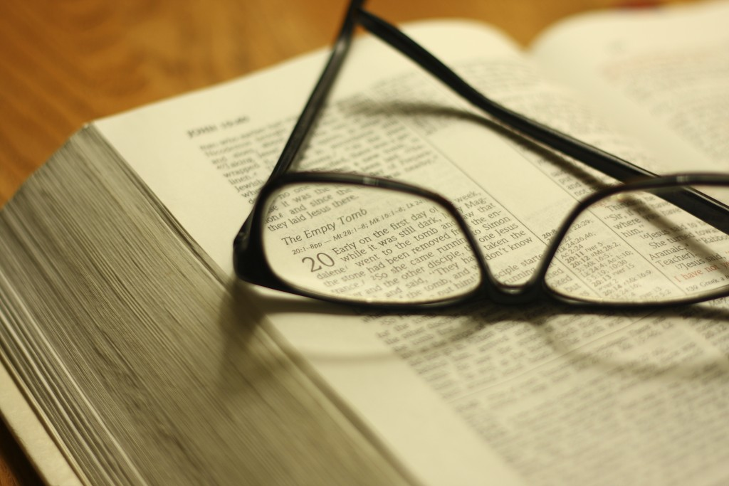 Glasses atop a Bible