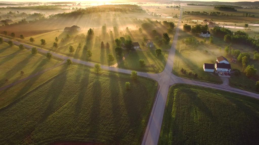 Magical sunrise through ground fog with long shadows and sunbeams.
