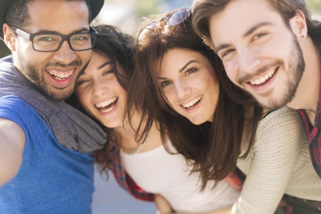 Group of friends taking a selfie in Barcelona.