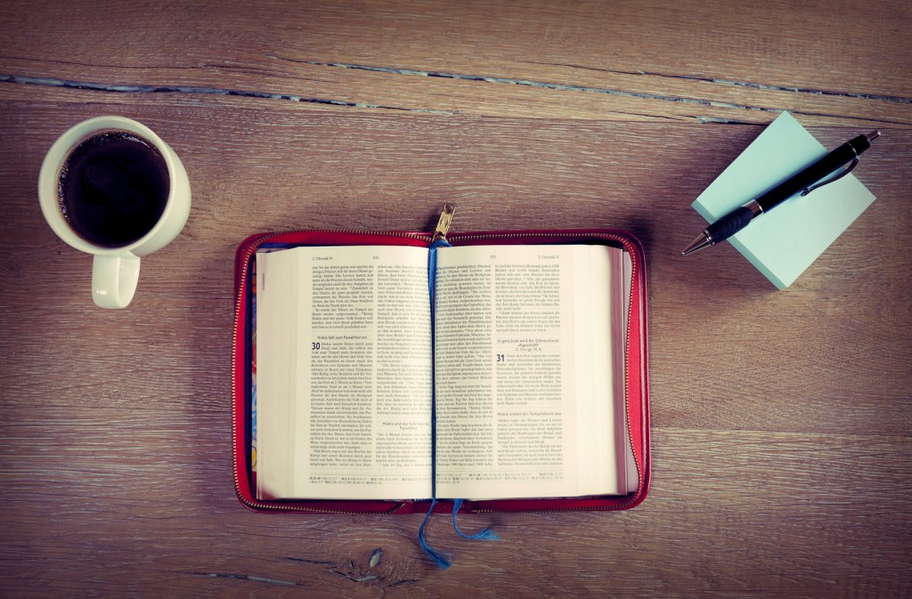 Open bible with coffee