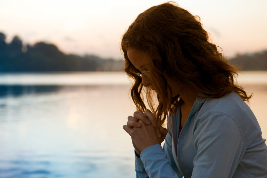 Woman In Prayer At Sunrise