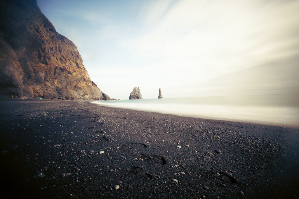 Black sand beach at Iceland. Quiet, peaceful remote place, perfect for relaxation. Iceland is great country where you can see a lot if waterfalls, rivers, lakes, mountains and beautiful unusual nature. Nature made great shapes of mountain, stones, scenes and you need to fall in love in this amazing island. In the winter and spring time there is no lot if green color, but everything is so enchanting.