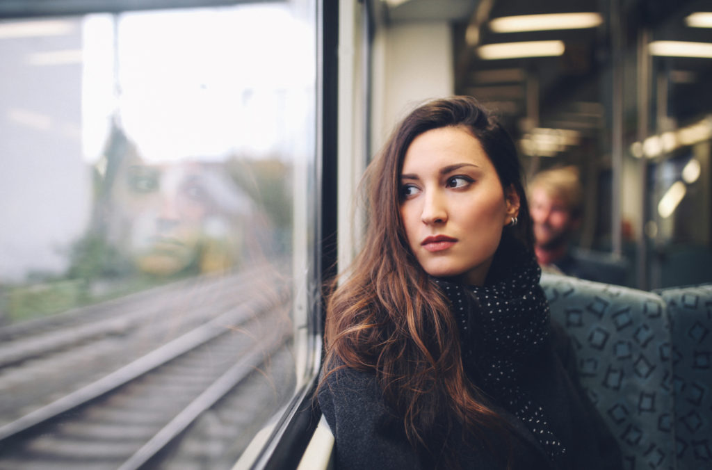 Woman riding on a train